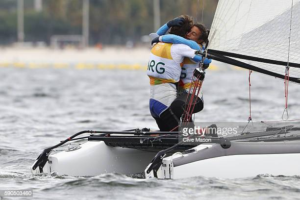Santiago Lange of Argentina and Cecilia Carranza Saroli of Argentina celebrate winning the gold medal in the Nacra 17 Mixed class on Day 11 of the...