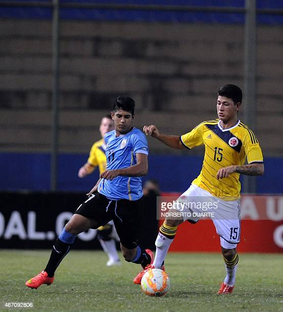 Santiago Maderos of Uruguay and Jorge Carrascal of Colombia vie for the ball during their South American U17 final round football match at Nicolas...
