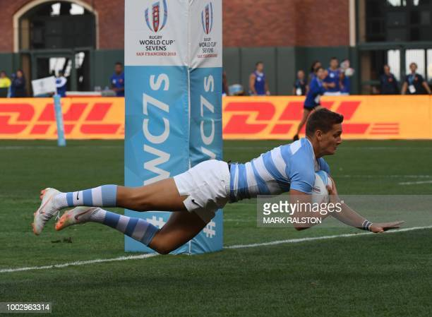 Santiago Mare of Argentina scores a try against Canada during their men's round of 16 game at the Rugby Sevens World Cup in the ATT Park at San...