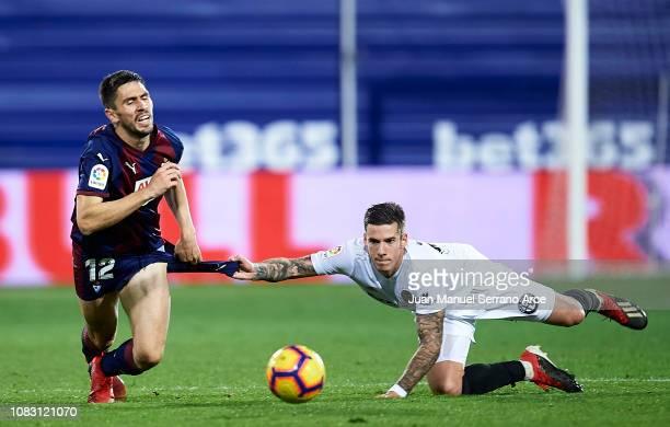 Santiago Mina of Valencia CF duels for the ball with Paulo Oliveira of SD Eibar during the La Liga match between SD Eibar and Valencia CF at Ipurua...