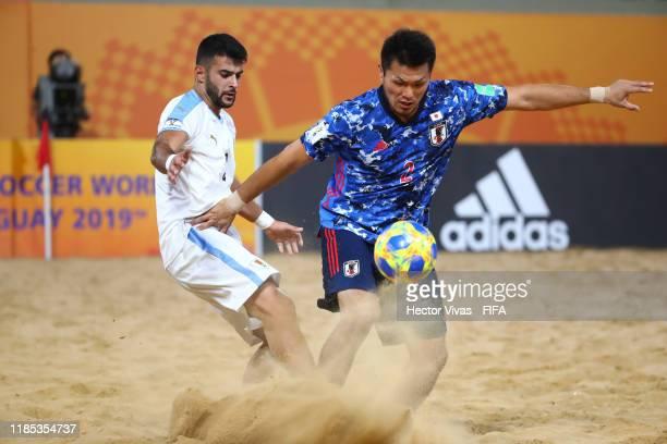 Santiago Miranda of Uruguay struggles for the ball with Takuya Akaguma of Japan during the FIFA Beach Soccer World Cup Paraguay 2019 quarter final...