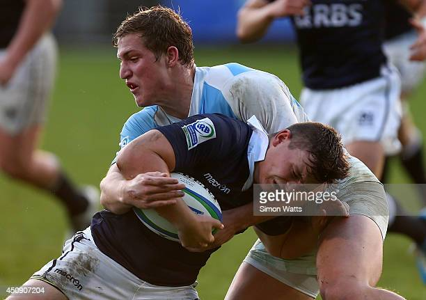 Santiago Montagner of Argentina tackles Blair Hutchinson of Scotland during the 2014 Junior World Championship match between Argentina and Scotland...