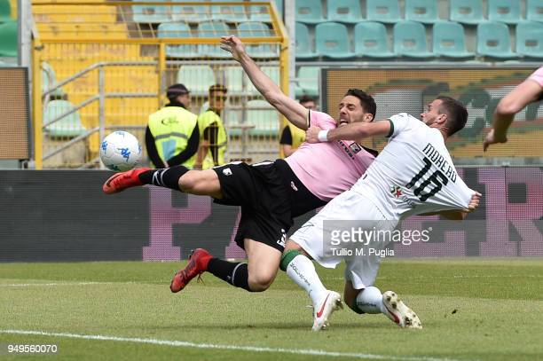 Santiago Morero of Avellino fouls Andrea Rispoli of Palermo during the serie A match between US Citta di Palermo and US Avellino at Stadio Renzo...