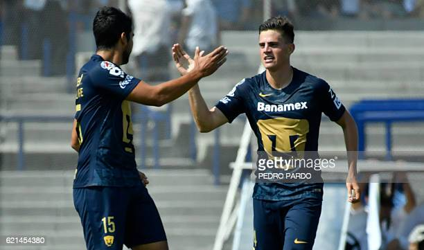 Santiago Palacios of Pumas celebrates with his teammate Eduardo Herrera after scoring against Morelia during their Mexican Apertura tournament...