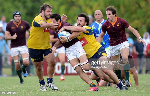 Santiago Pasman of Newman is grabbed of his head during a match between Newman and La Plata as part of ICBC Nacional de Clubes at Club Newman on...