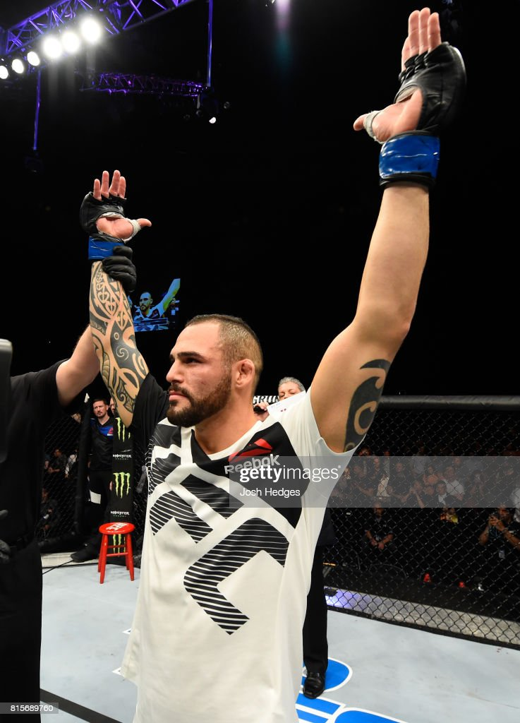 Santiago Ponzinibbio of Argentina celebrates his victory over Gunnar Nelson of Iceland in their welterweight bout during the UFC Fight Night event at the SSE Hydro Arena Glasgow on July 16, 2017 in Glasgow, Scotland.