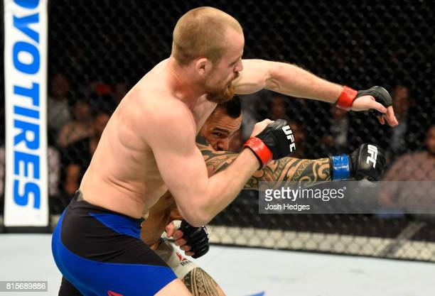 Santiago Ponzinibbio of Argentina punches Gunnar Nelson of Iceland in their welterweight bout during the UFC Fight Night event at the SSE Hydro Arena...