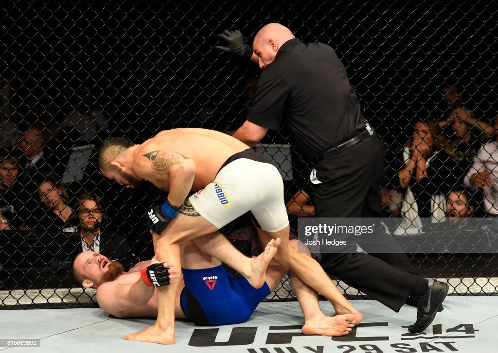 Santiago Ponzinibbio of Argentina punches Gunnar Nelson of Iceland in their welterweight bout during the UFC Fight Night event at the SSE Hydro Arena Glasgow on July 16, 2017 in Glasgow, Scotland.
