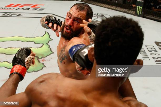Santiago Ponzinibbio of Argentina punches Neil Magny in their welterweight bout during the UFC Fight Night event inside Arena Parque Roca on November...