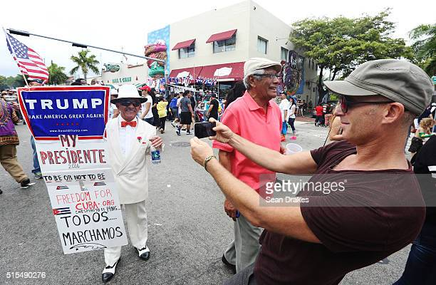 Santiago Portal who migrated from Cuba 50 years ago displays a sign supporting US Presidential candidate Donald Trump on 8th Street in the Little...