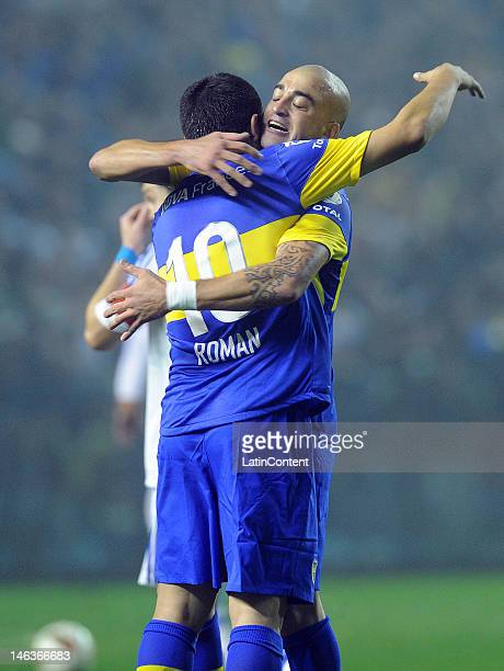 Santiago Silva and Juan Roman Riquelme of Boca celebrate the first goal of their team during the first leg of the Copa Libertadores 2012 semi-finals...