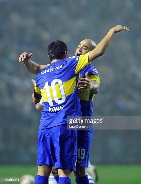 Santiago Silva from Boca Jrs celebrate a goal with Juan Roman Riquelme during the first leg of the Copa Libertadores 2012 semifinals between Boca Jrs...