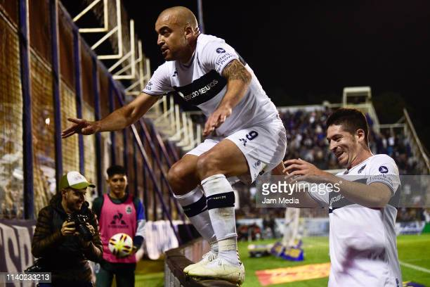 Santiago Silva of Gimnasia y Esgrima celebrates after scoring his side's first goal during a round of sixteen second leg match between Gimnasia y...