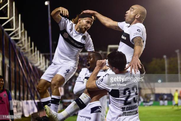 Santiago Silva of Gimnasia y Esgrima celebrates with teammates after scoring his side's first goal during a round of sixteen second leg match between...