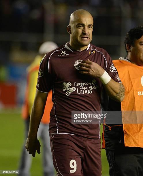 Santiago Silva of Lanús looks dejected as he walks out of the field after a second leg quarter final match between Bol'ívar and Lanœús as part of...