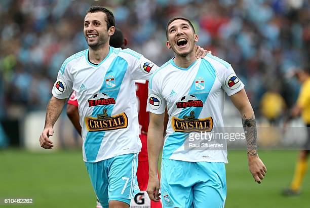 Santiago Silva of Sporting Cristal celebrates with teammate Horacio Calcaterra after scoring the third goal of his team during a match between...