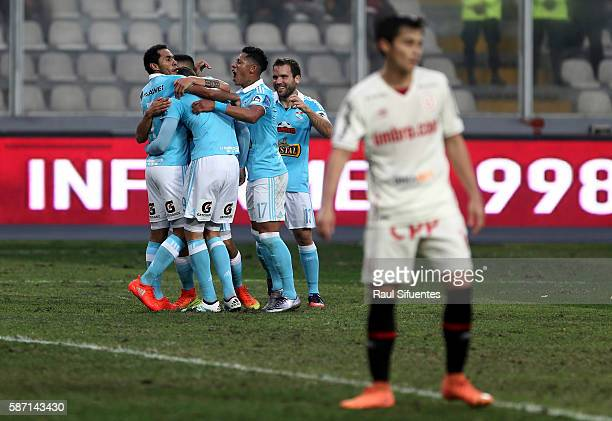Santiago Silva of Sporting Cristal celebrates with teammates after scoring the second goal of his team against Universitario during a match between...