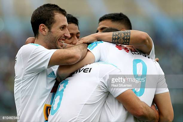 Santiago Silva of Sporting Cristal celebrates with teammates after scoring the third goal of his team during a match between Sporting Cristal and...