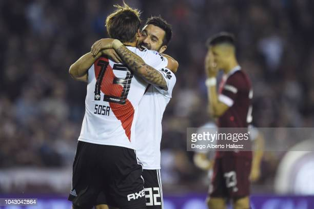 Santiago Sosa celebrates the own goal scored by Matias Ibañez of Lanus with Ignacio Scocco during a match between Lanus and River Plate as part of...
