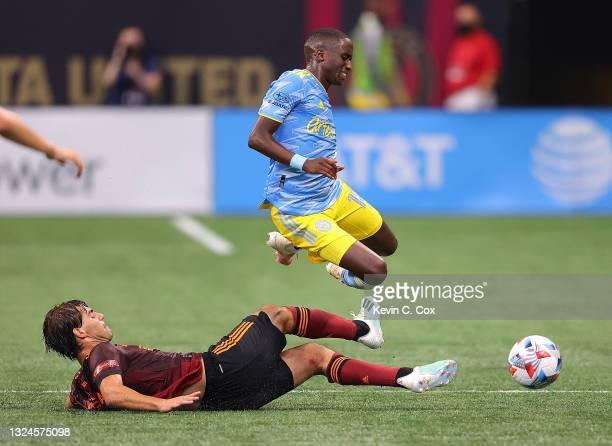 Santiago Sosa of Atlanta United challenges Jamiro Monteiro of Philadelphia Union during the first half at Mercedes-Benz Stadium on June 20, 2021 in...