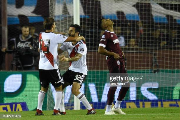 Santiago Sosa of River Plate celebrates after scoring with the teammate Ignacio Scocco during a match between Lanus and River Plate as part of...