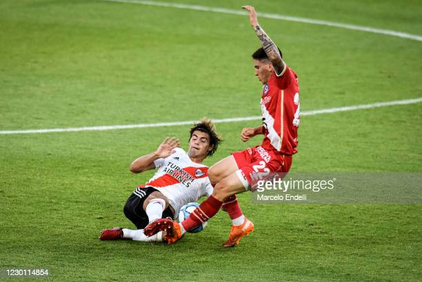 Santiago Sosa of River Plate fights for the ball with Franco Ibarra of Argentinos Juniors during a match between River Plate and Argentinos Juniors...