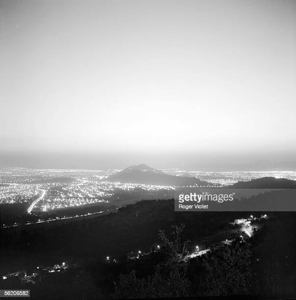 Santiago Two suburbs of the city the night seen SaintChristophe hill January 1969