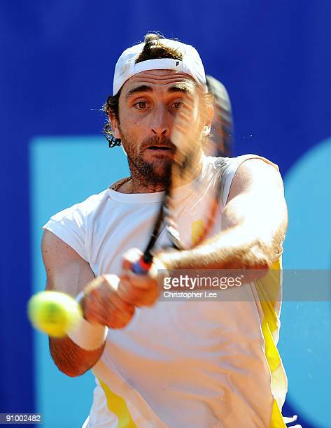 Santiago Ventura of Spain in action against Robert Coman of Romania during the Qualifying Round of The BCR Open Romania at the BNR Arena on September...