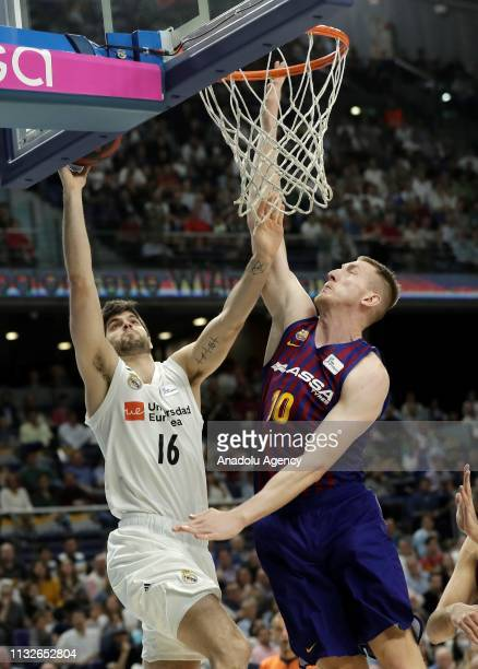 Santiago Yusta of Real Madrid in action against Rolands Smits of Barcelona Lassa during the Liga Endesa week 24 match between Real Madrid and FC...