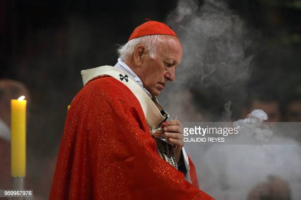 Santiago's Archbishop Ricardo Ezzati celebrates mass at the Metropolitan Cathedral in Santiago on May 18 2018 After three days of meetings with Pope...
