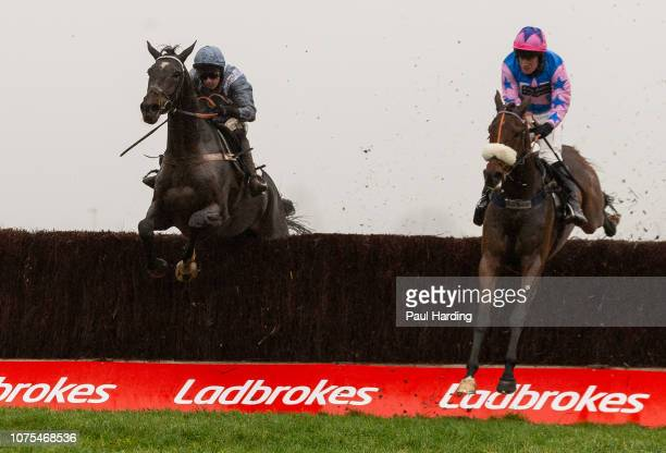 Santini ridden by Nico de Boinville jumps the last fence and runs through to win the 1245 Ladbrokes John Francome Novices' Chase ahead of Rocky's...