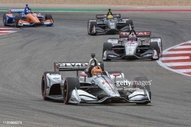 Santino Ferrucci of Dale Coyne Racing driving a Honda leads the pack through turn 15 during the IndyCar Classic at Circuit of the Americas on March...