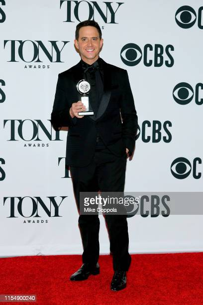 "Santino Fontana, winner of the award for Best Performance by an Actor in a Leading Role in a Musical for ""Tootsie,"" poses in the press room for the..."