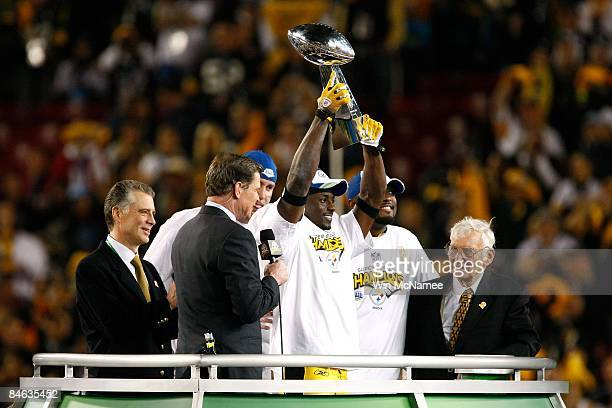 Santonio Holmes of of the Pittsburgh Steelers celebrates with the Vince Lombardi Trophy as team owner Dan Rooney looks on after the Steelers won 2723...