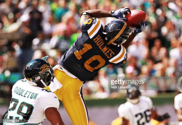 Santonio Holmes of the New York Jets catches a first quarter touchdown against the Jacksonville Jaguars at MetLife Stadium Stadium on September 18...