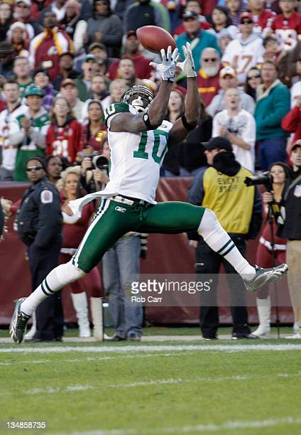 Santonio Holmes of the New York Jets catches a touchdown pass against the Washington Redskins during the second half at FedExField on December 4 2011...