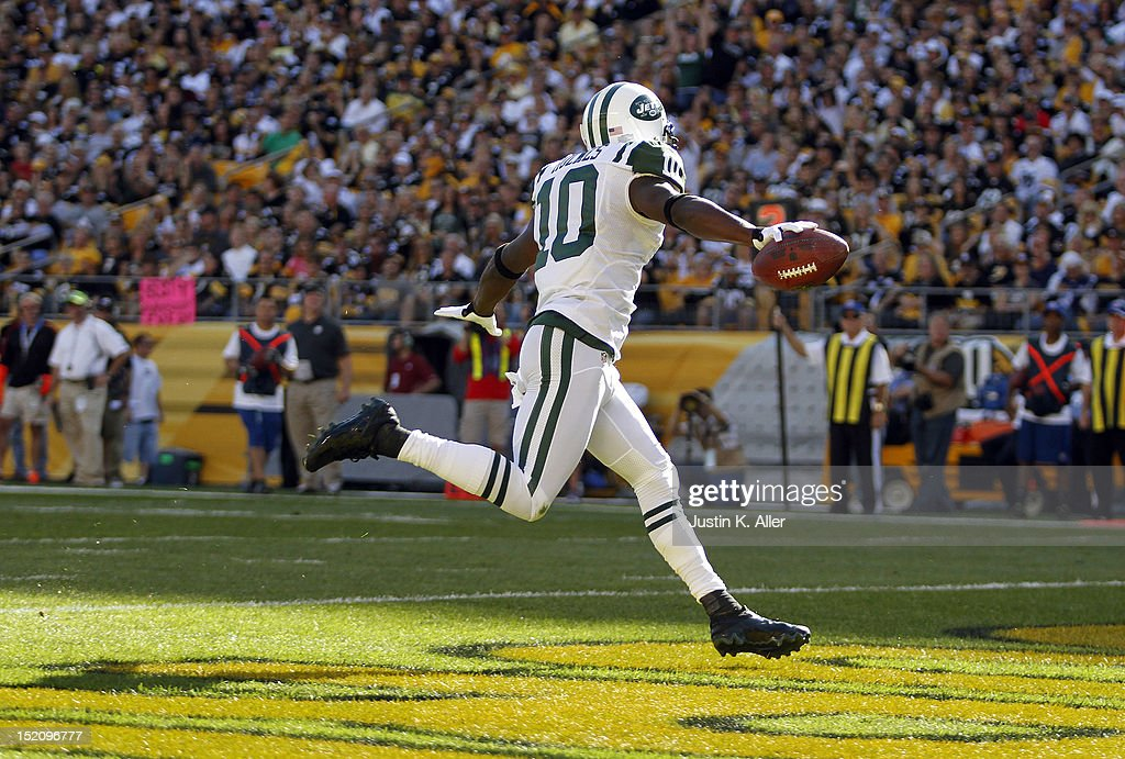 Santonio Holmes #10 of the New York Jets celebrates his first half touchdown against the Pittsburgh Steelers during the game on September 16, 2012 at Heinz Field in Pittsburgh, Pennsylvania.