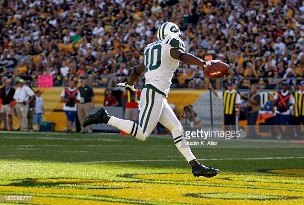 Santonio Holmes of the New York Jets celebrates his first half touchdown against the Pittsburgh Steelers during the game on September 16 2012 at...