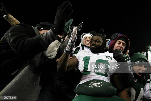 Santonio Holmes of the New York Jets celebrates with fans after the Jets defeated the Patriots 28 to 21 in their 2011 AFC divisional playoff game at...