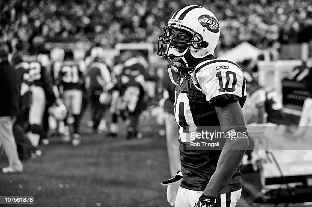 Santonio Holmes of the New York Jets looks on from the bench during the fourth quarter against the Cincinnati Bengals on November 25 2010 at the New...