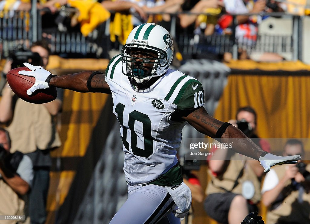 Santonio Holmes #10 of the New York Jets reacts after scoring a first quarter touchdown against the Pittsburgh Steelers on September 16, 2012 at Heinz Field in Pittsburgh, Pennsylvania.