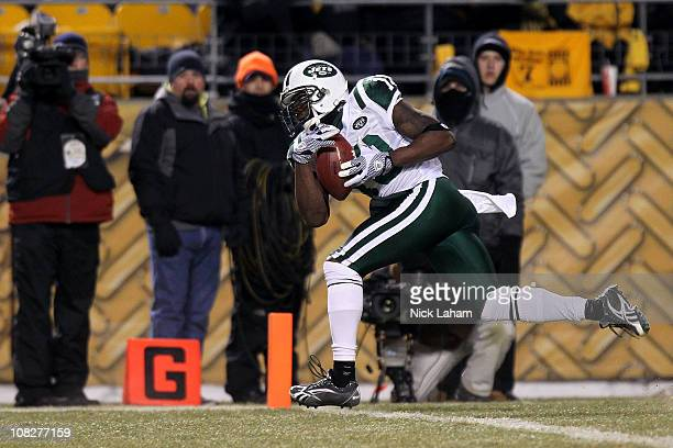 Santonio Holmes of the New York Jets scores a third quarter touchdown against the Pittsburgh Steelers during the 2011 AFC Championship game at Heinz...