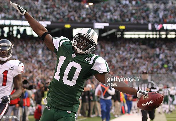 Santonio Holmes of the New York Jets scores a touchdown against the Houston Texans during the third quarter of their game on November 21 2010 at the...