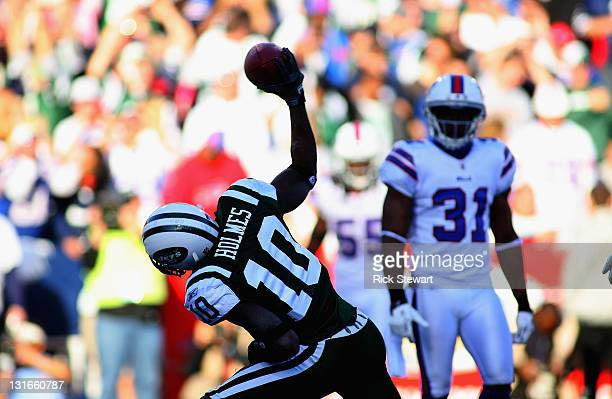 Santonio Holmes of the New York Jets spikes the ball after scoring a touchdown against the Buffalo Bills at Ralph Wilson Stadium on November 6 2011...