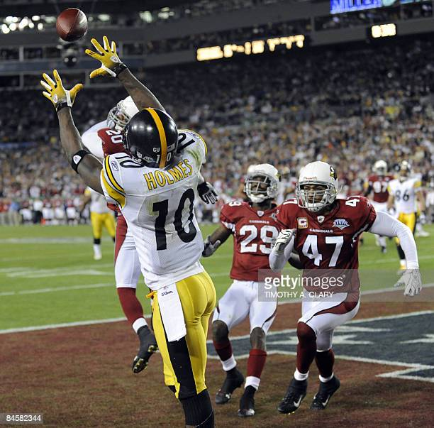 Santonio Holmes of the Pittsburgh Steelers catches a seven-yard touchdown pass with 35 seconds remaining for a 27-23 victory over the Arizona...