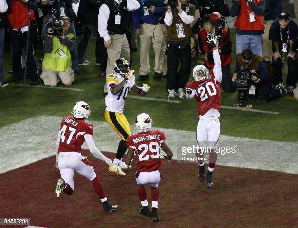 Santonio Holmes of the Pittsburgh Steelers catches a touchdown in fourth quarter against Aaron Francisco and Dominique Rodgers-Cromartie of the...