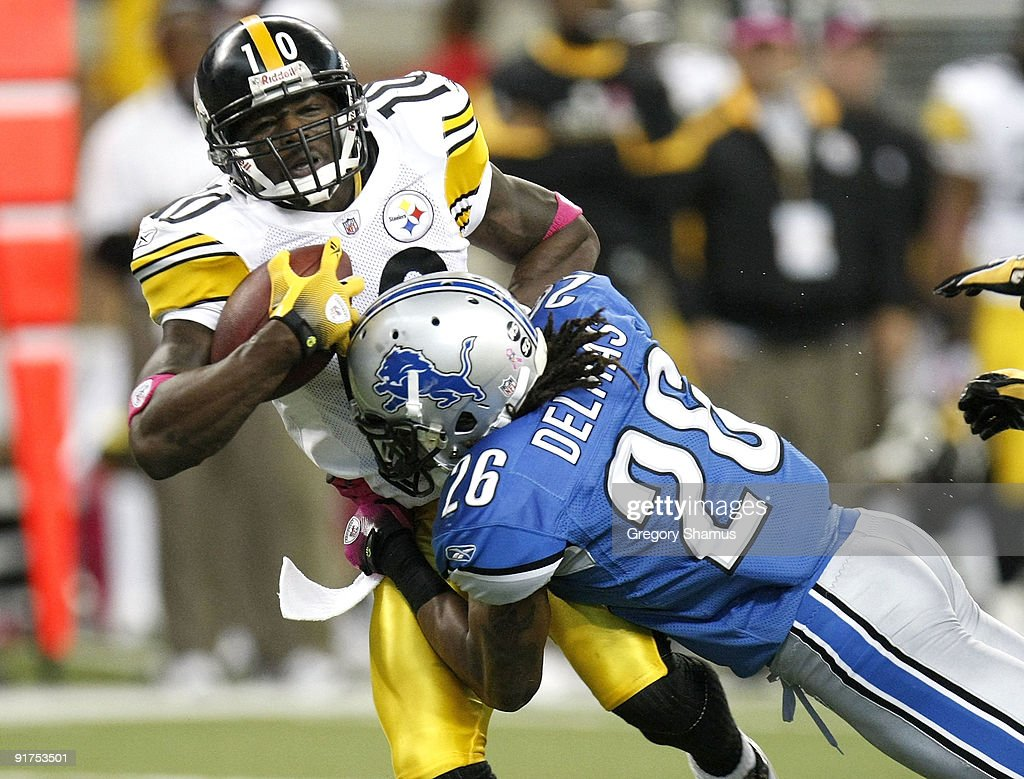 Santonio Holmes #10 of the Pittsburgh Steelers is tackled after making a second quarter catch by Louis Delmas #28 of the Detroit Lions on October 11, 2009 at Ford Field in Detroit, Michigan.