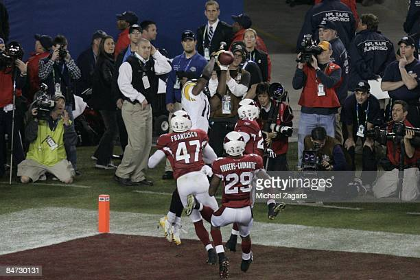 Santonio Holmes of the Pittsburgh Steelers makes a 6yard touchdown reception in the final minutes of the game against the Arizona Cardinals during...