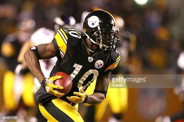 Santonio Holmes of the Pittsburgh Steelers runs for yards after the catch on his 65-yard touchdown reception in the second quarter against the...