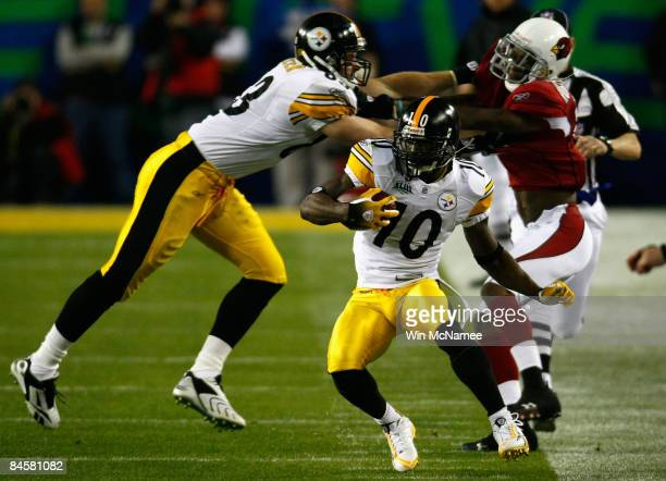 Santonio Holmes of the Pittsburgh Steelers runs with the ball in the first quarter against the Arizona Cardinals during Super Bowl XLIII on February...